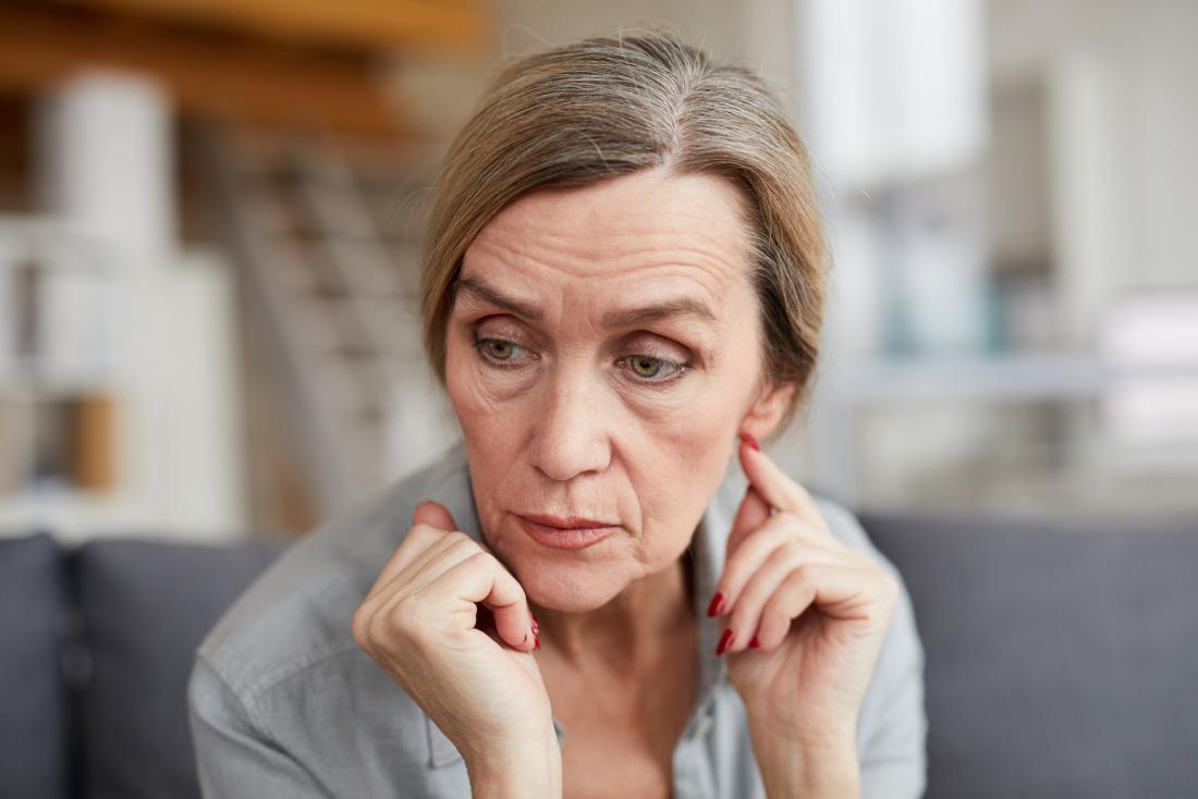 older woman looking preoccupied
